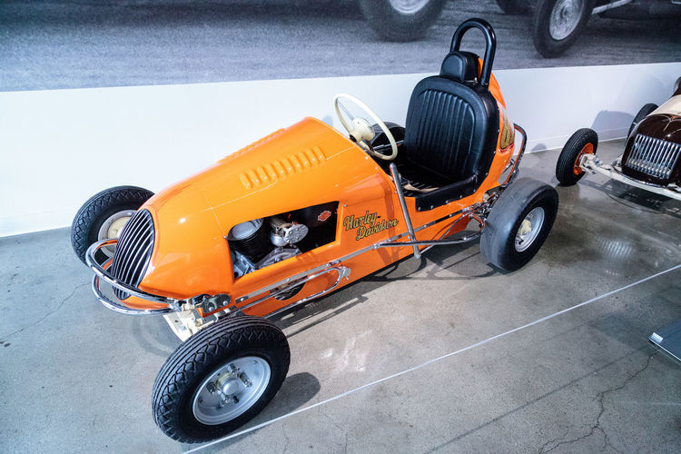 Los Angeles, CA, USA - March 4, 2017: Orange 1949 Unidentified three fourth midget racer powered by a Harley-Davidson engine at the Petersen Automotive Museum in Los Angeles, California, United States. Editorial only. 1949 Boxcar Car Change Classic Classic Car Day Harley Harley-Davidson Harleydavidson Land Vehicle Midget Motor No People Old Outdoors Racecar Racer Tire Transportation Vintage