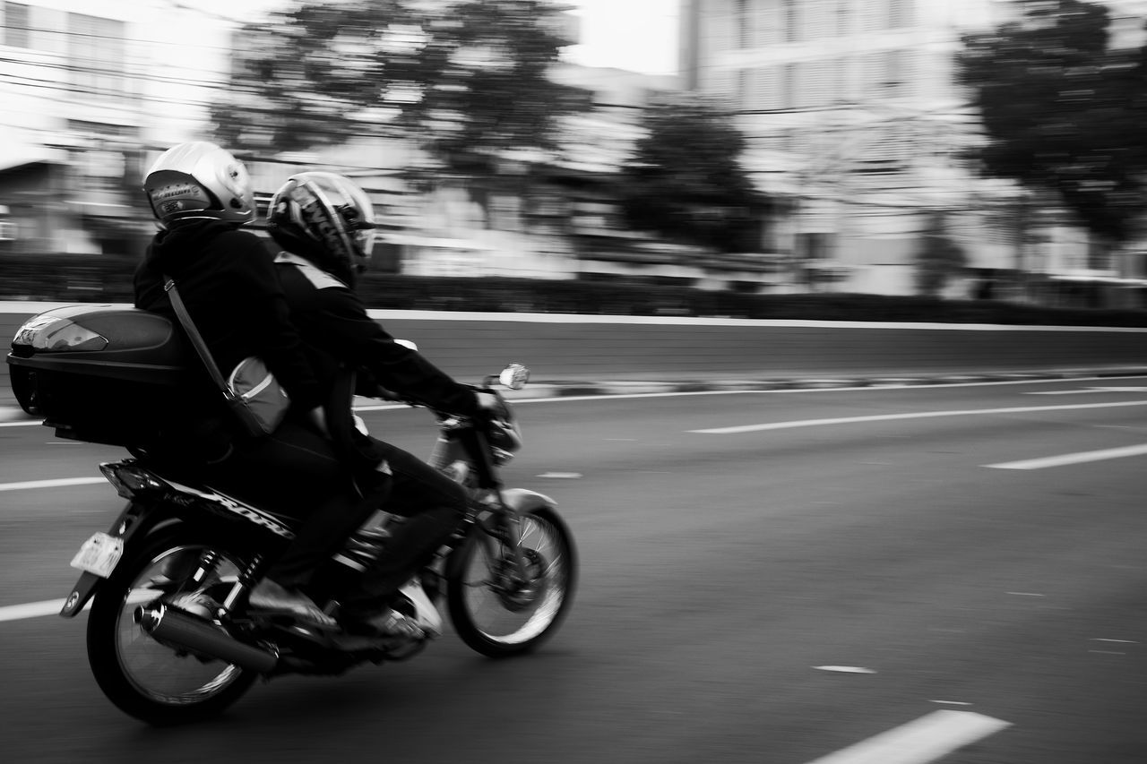 speed, riding, transportation, real people, motion, motorcycle, blurred motion, land vehicle, mode of transport, helmet, road, lifestyles, outdoors, men, leisure activity, day, adventure, one person, full length, biker, headwear, people