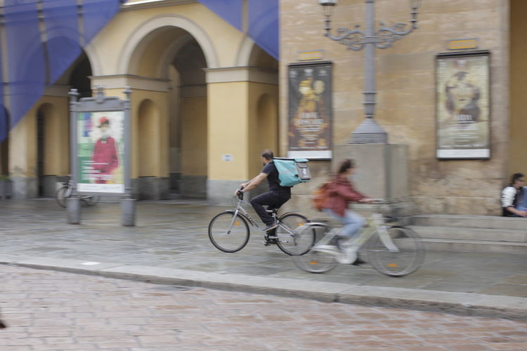 Bicycle on street against building in city