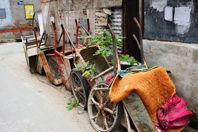 Old Damaged Rusty Carts On Footpath