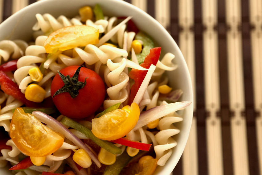Fusilli salad with yellow and red cherry tomatoes, red and green pepper, sliced onion and corn grains bowl. Lateral view closeup. Fusilli Natural Light Salad Spanish Onion Cherry Tomatoes Corn Grain Directly Above Food Food And Drink Freshness Fusilli Pasta Fusilli Salad Green Peppers Healthy Eating Italian Food No People Pasta Salad Ready-to-eat Red Peppers Striped Background Studio Photography Summer Salad Tomato Yellow Cherry Tomato