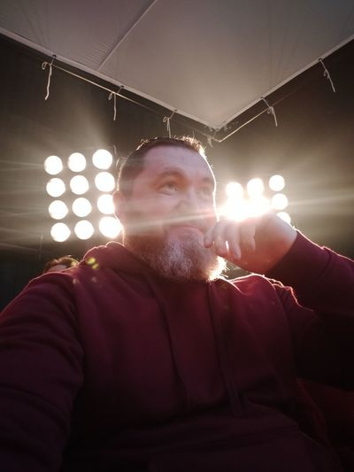 Low angle portrait of man with illuminated lights