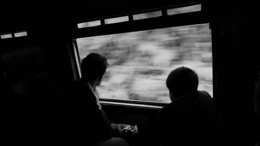 Silhouette of men in train