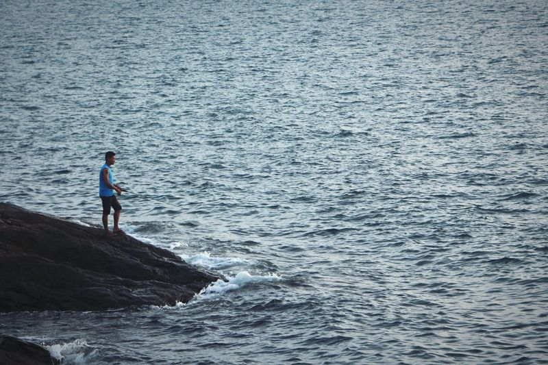 Little man in a big world Fishing Islandlife Island Water Sea Real People One Person Leisure Activity Waterfront Beauty In Nature Wave Lifestyles