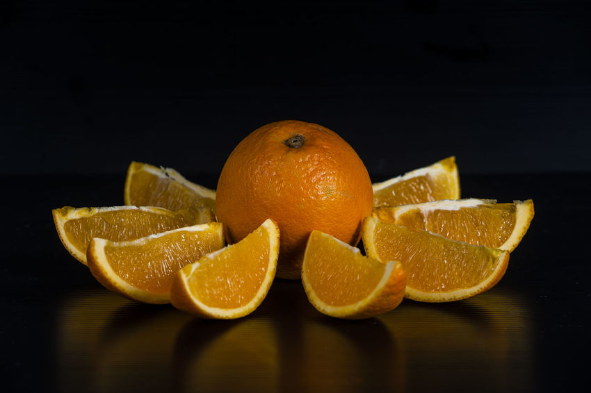 Black Background Close-up Food Food And Beverages Food And Drink Fresh Fresh Oranges Freshness Fruit Fruits Healthy Eating Healthy Food Indoors  Juice Juicy Oranges Orange Color Oranges Product Reflections Slices Still Life Studio Shot Sweet And Juicy Table Yellow