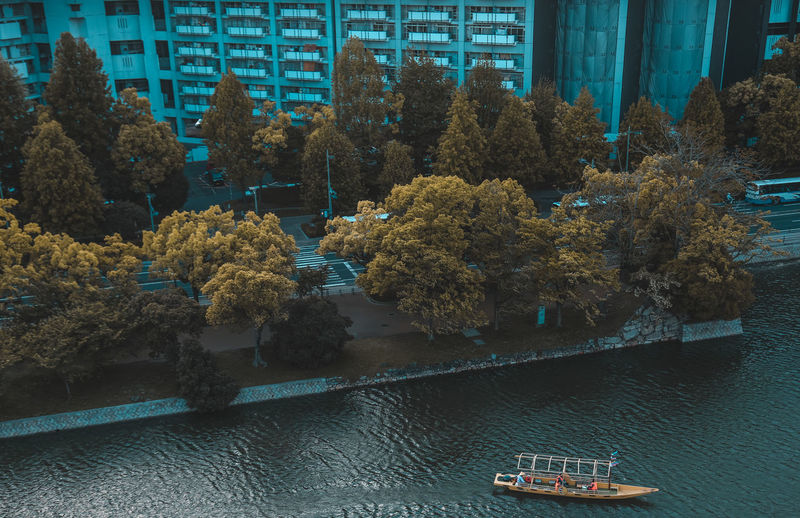 High Angle View Of Boat Moored On River In City