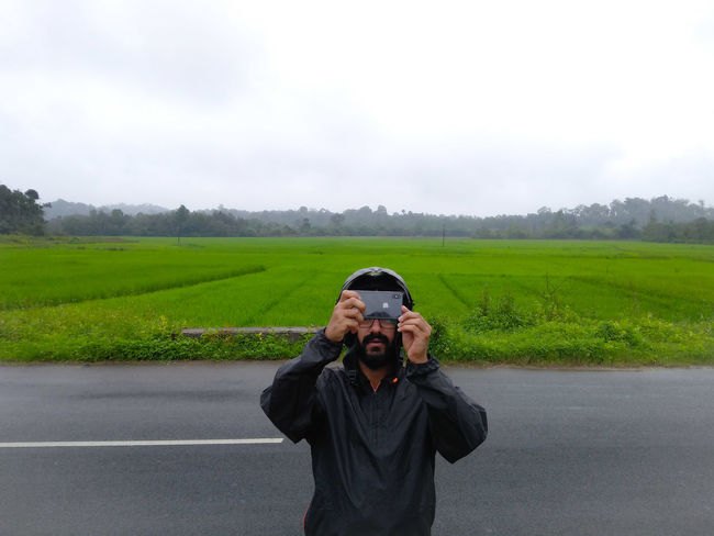 let's click EyeEm Gallery Eyeemphotography Click Click 📷📷📷 Clicking Photos Rural Scene Portrait Looking At Camera Agriculture Standing Front View Road Sky Landscape Monsoon Cultivated Land Crop  Plantation Rice Paddy RainDrop Rain Farmland Farm Wet Agricultural Field Rainy Season