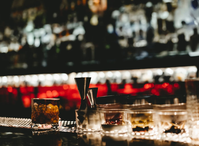 View of nightclub beer bar with alcoholic bottles stacked on shelf
