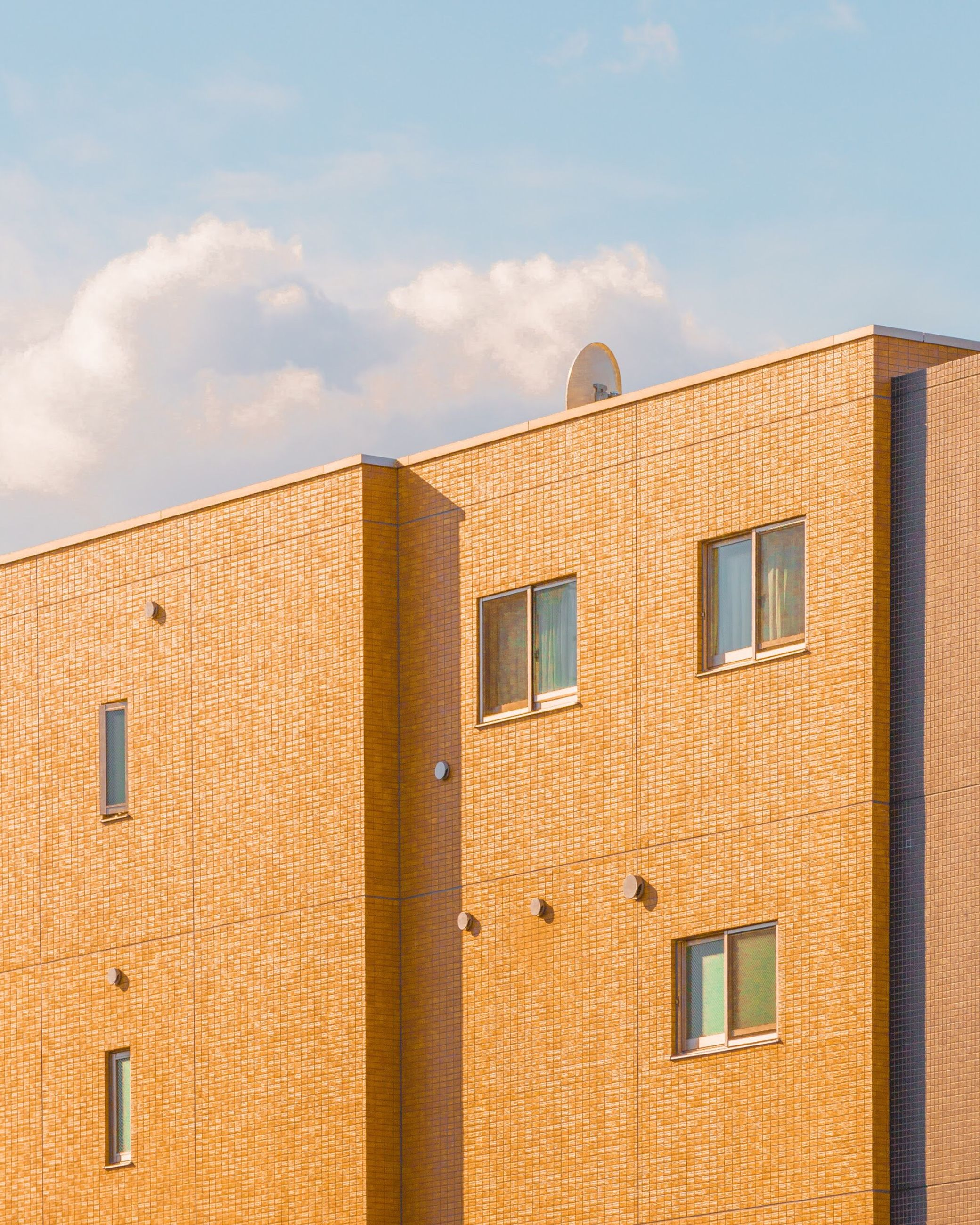 architecture, building exterior, window, built structure, low angle view, sky, cloud - sky, outdoors, no people, day, city