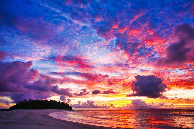 Paradise Beach at the Fiji Islands Fiji Fiji Islands Island Tropic Sky Beauty In Nature Cloud - Sky Scenics - Nature Tranquil Scene Tranquility Land Idyllic No People Nature Outdoors Water Sea Sunset Beach Orange Color Horizon Horizon Over Water Dramatic Sky