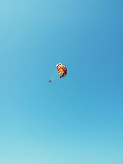 WeekOnEyeEm Outdoor Photography Sky Paragliding Parachute Flying Mid-air Clear Sky Blue Extreme Sports Full Length Sky Fly Be Brave A New Beginning My Best Photo The Minimalist - 2019 EyeEm Awards The Mobile Photographer - 2019 EyeEm Awards