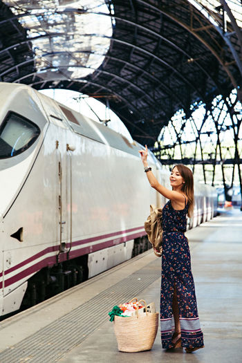 Adult Beautiful Woman Casual Clothing Day Full Length Happiness Leisure Activity Lifestyles One Person Outdoors People Real People Standing Train Train Station Transportation Traveling Waiting Young Adult Young Women