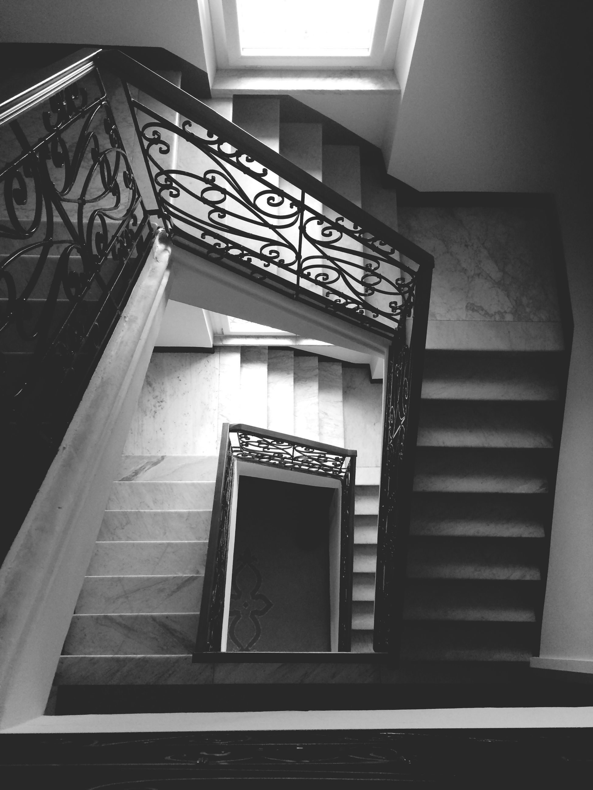 architecture, indoors, built structure, steps, staircase, steps and staircases, low angle view, railing, design, pattern, building, building exterior, no people, wall - building feature, stairs, window, architectural feature, ceiling, day, door
