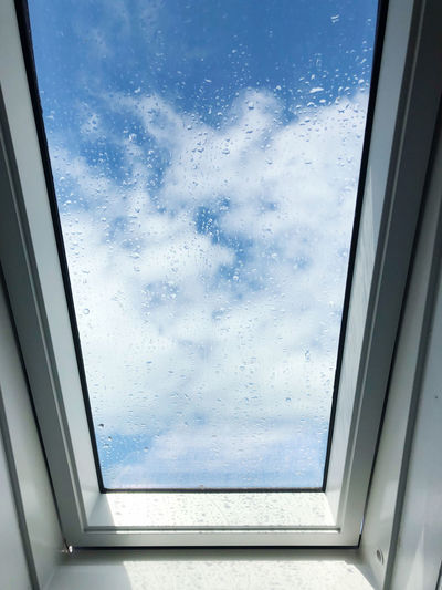 Low angle view of glass window