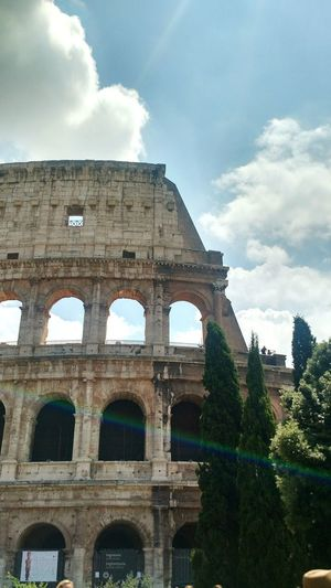 Colloseum Light Rays Architecture Arch Cloud - Sky History Built Structure Travel Destinations Sky Old Ruin Outdoors No People City Ancient Civilization Travel