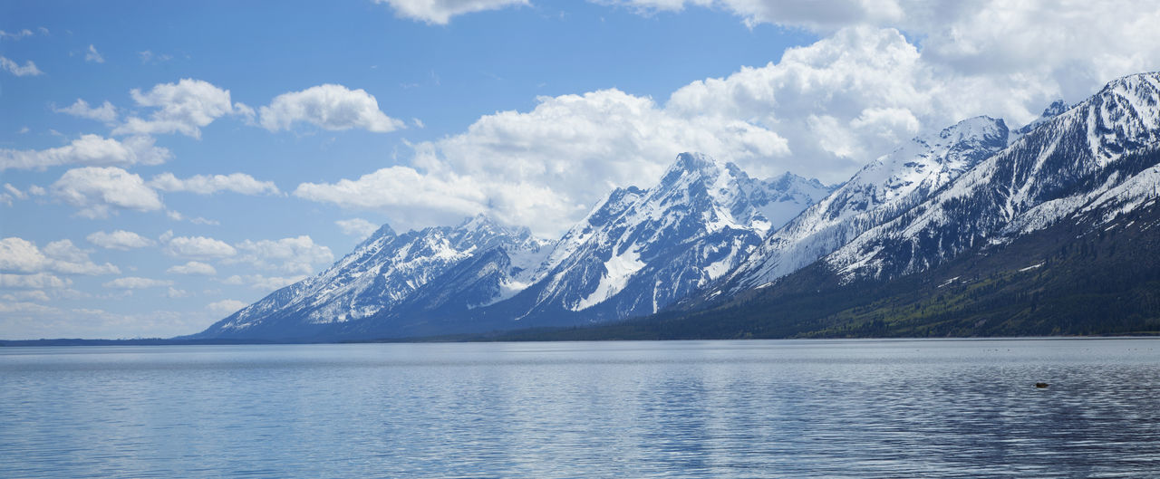 Lewis Lake below the Grand Teton mountains in Wyoming Cloud - Sky Day Grand Tetons Lake Lewis Lake Mountain No People Snowcapped USA Water West Wyoming