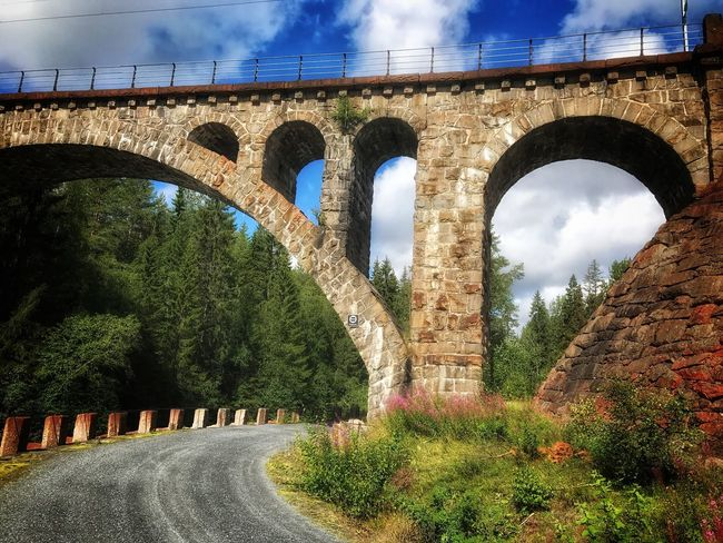 Meheia bridge outside Notodden, Norway Arch Bridge - Man Made Structure Connection Architecture Day Transportation Built Structure Cloud - Sky No People Nature Tree Road Sky Outdoors Growth