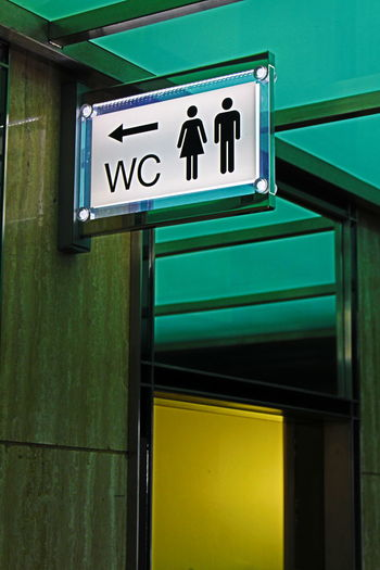 Low Angle View Of Restroom Signs