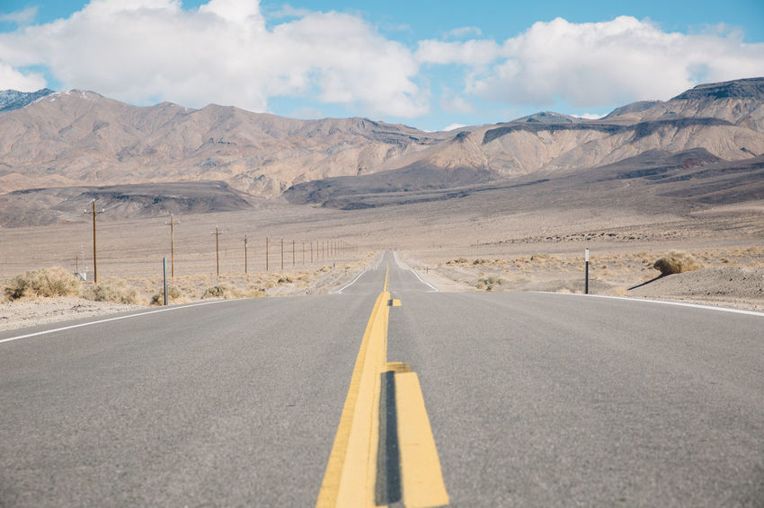 Arid Climate Asphalt Blue Sky CA-190 Coso Day Death Valley Desert Desert Landscape Mountain Mountain Range Mountains Nature Nature No People Olancha Outdoors Road Road Road Marking Roadtrip Sky The Way Forward Transportation