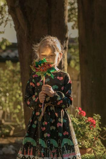 Girl holding pinwheel toy