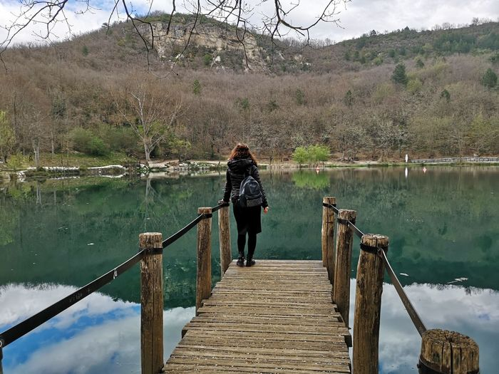 Water One Person Lake Real People Full Length Nature Tree Standing Plant Leisure Activity Lifestyles Beauty In Nature Reflection Casual Clothing Day Railing Tranquility Women Non-urban Scene Outdoors Sinizzo