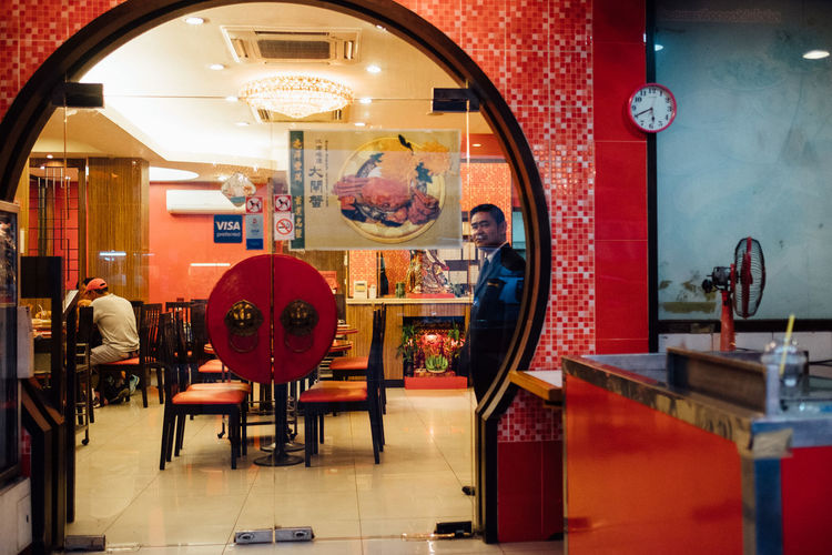Chinatown Bangkok Cafe Consumerism Customer  Day Illuminated Indoors  Men One Person People Real People Restaurant Retail  Store