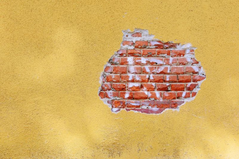 Api Brick Wall Bricks Yellow Yellow Paint Hole Spray Graffiti Art Background Texture Surface Industrail Architecture Colors And Patterns