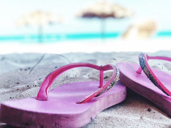 Close-up Pink Color Glasses Beach Focus On Foreground Selective Focus No People Sand Land Sunglasses Fashion Nature Still Life Textile Water Two Objects Outdoors Day