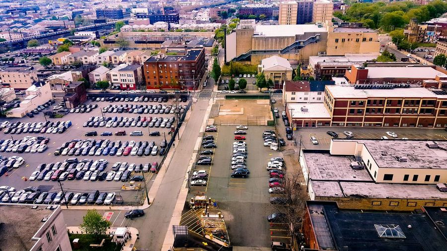 High Angle View Of Vehicles Parked At Parking Lot In City