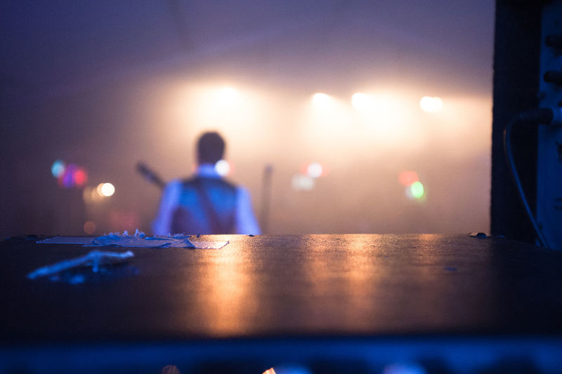 Rear view of musician playing at stage