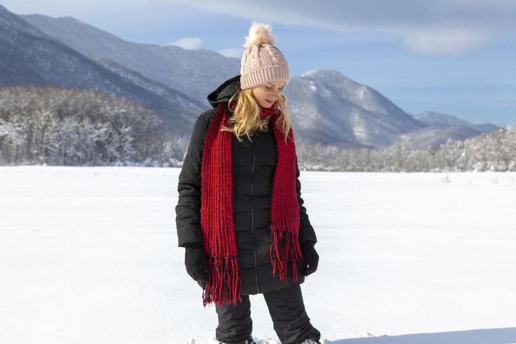 Woman is having winter fun on a snowy, sunny day in lika, croatia