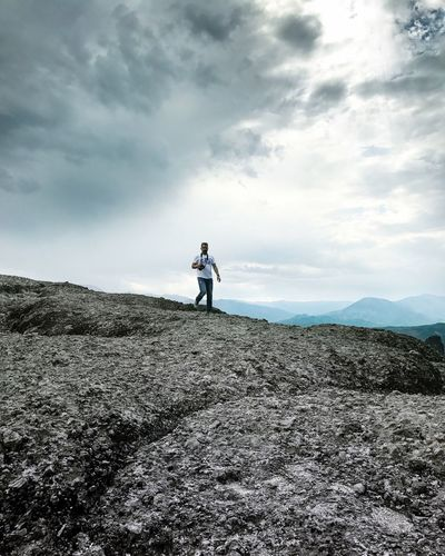 Cloud - Sky Sky Real People Full Length Leisure Activity One Person Nature Mountain Lifestyles Day Men Beauty In Nature Scenics Walking Adventure Landscape Outdoors Standing Women People Gettyimagesgallery Getty X EyeEm Getty+EyeEm Collection Let's Go. Together.