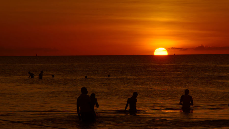Sun Set view in Zanzibar Beach Beauty In Nature Enjoyment Hamids Lens Horizon Over Water Large Group Of People Leisure Activity Lifestyles Men Nature Outdoors People Real People Scenics Sea Silhouette Sky Standing Sun Sunset Vacations Water Weekend Activities Women