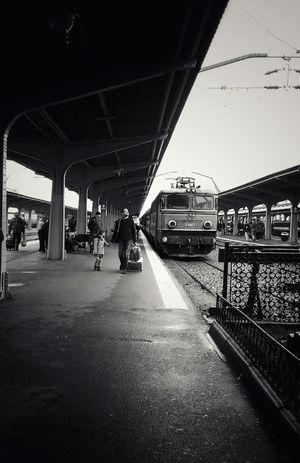People Outdoors Railroad Station Platform