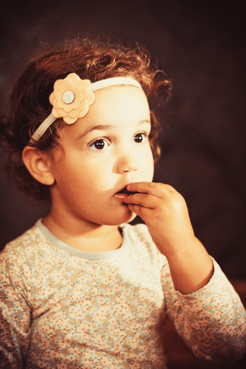 Portrait of little girl eating chocolate.