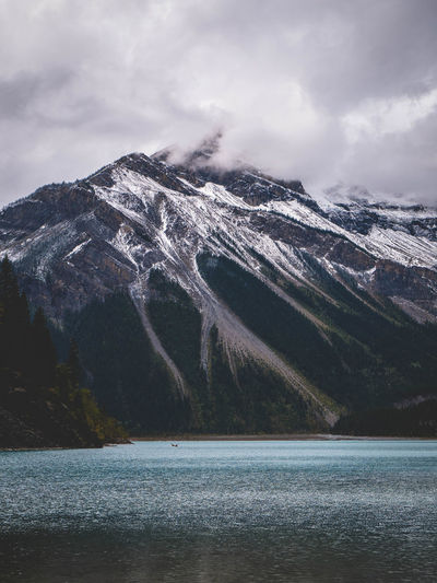 Foggy Mountain and Lake View Mountain Scenics - Nature Water Beauty In Nature Nature Cold Temperature Cloud - Sky Sky Mountain Range Winter Lake Snow Tranquil Scene Tranquility No People Waterfront Day Environment Mountain Peak Snowcapped Mountain Outdoors View Into Land