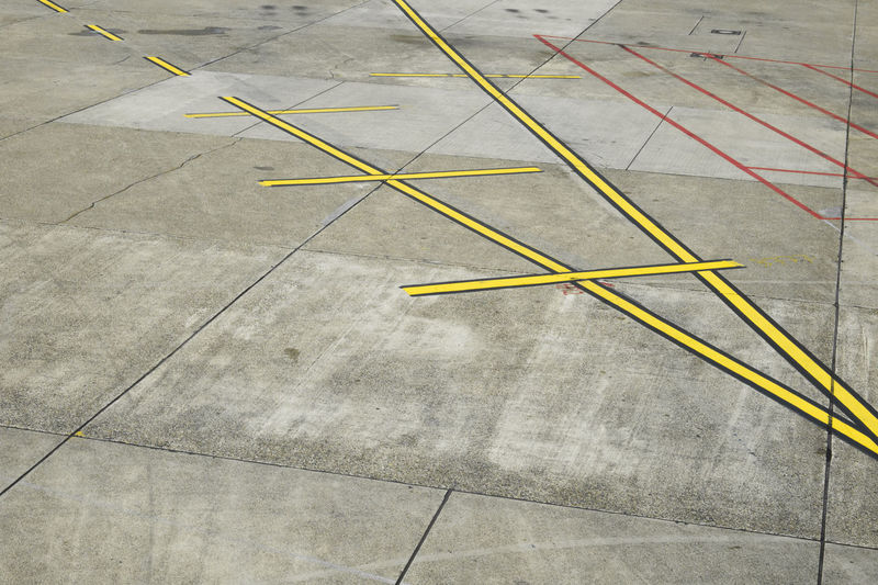 Detail of airport runway at daylight. Road Runway Stripes Transportation Travel Airfield Airport Aviation Backgrounds