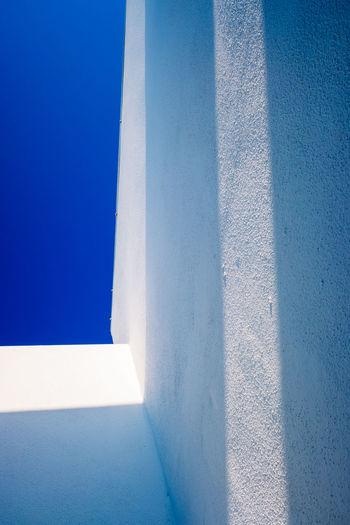 White wall against blue sky