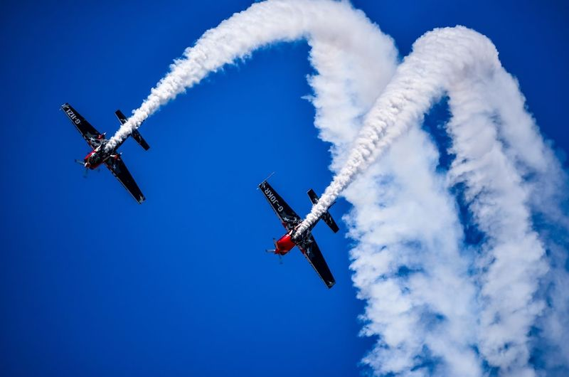 blade point Airshow Vapor Trail Smoke - Physical Structure Speed Airplane Transportation Blue Flying Low Angle View Sky Performance Teamwork Air Vehicle Aerobatics Mid-air Mode Of Transport Day Outdoors Clear Sky Formation Flying