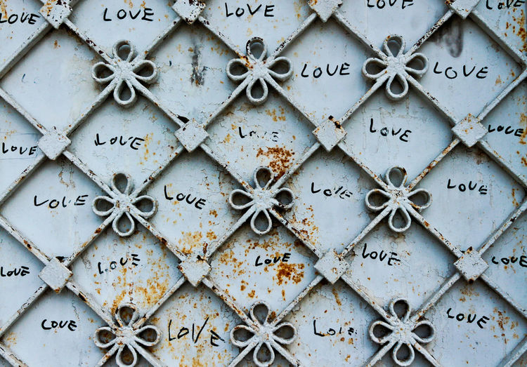 Close-Up Of Metal Gate With Love Text