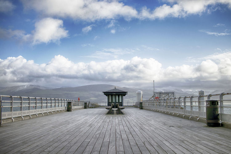 Cloud - Sky Sky Architecture Built Structure Day Direction The Way Forward Nature Railing Footpath Pier Outdoors Water Transportation Wood - Material Beauty In Nature No People Empty Tranquil Scene Long Beaumaris Pier