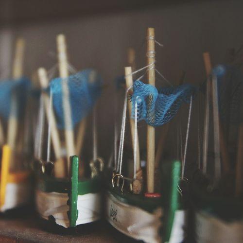 Close-Up Of Boat Toys On Shelf