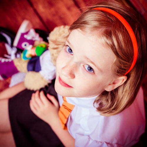 High angle portrait of cute schoolgirl