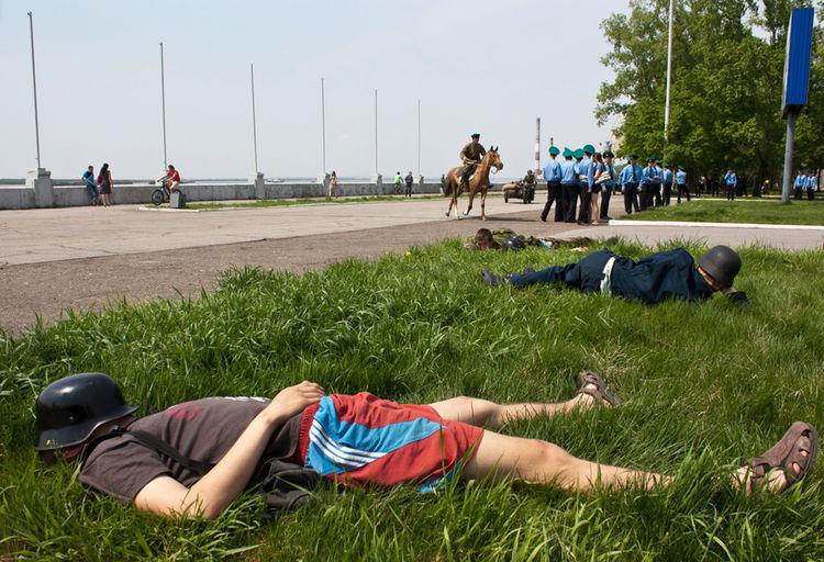 People lying on grassland