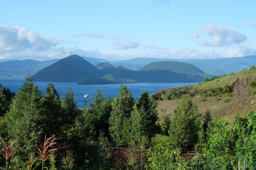 Hokkaido Islands Shikotsu Toya National Park Beauty In Nature Caldera Lake Day Growth Lake Lake Toya Mountain Mountain Range Nakajima Nature No People Outdoors Plant Scenics - Nature Sky Tranquil Scene Tranquility Tree Volcanic Landscape Volcano Water