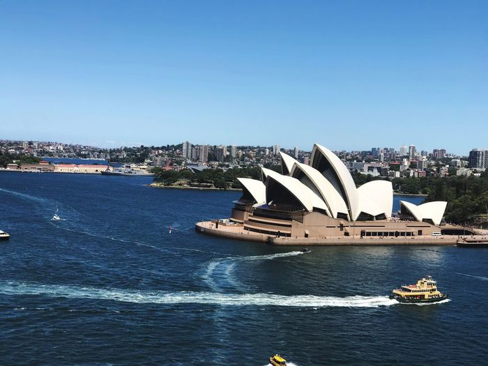 Opera house Sky Architecture Water Building Exterior Built Structure City Copy Space Clear Sky Travel Destinations Nature Blue Transportation No People Day Cityscape Travel Arts Culture And Entertainment Outdoors Modern Cruise Ship