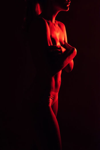 Red Indoors  Studio Shot Black Background One Person Human Body Part Adult Body Part Young Adult Dark Close-up Women Copy Space Cut Out Front View Females Contemplation Human Face