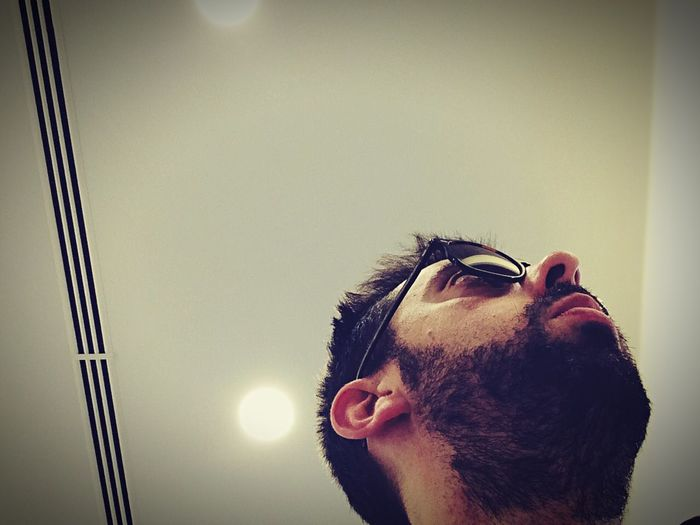 Low angle view of man looking away