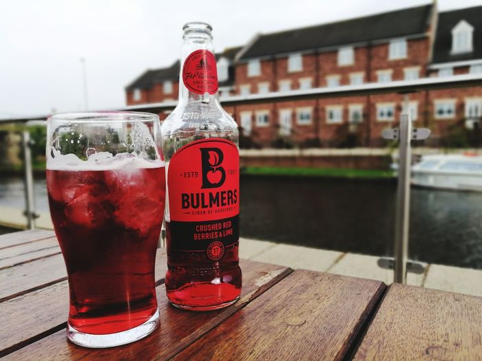 Red is hot 😉. Drink Food And Drink Drinking Glass Text Red Refreshment Cold Drink Cold Temperature No People Day Outdoors Water Close-up Freshness Building Exterior Bulmers Cider