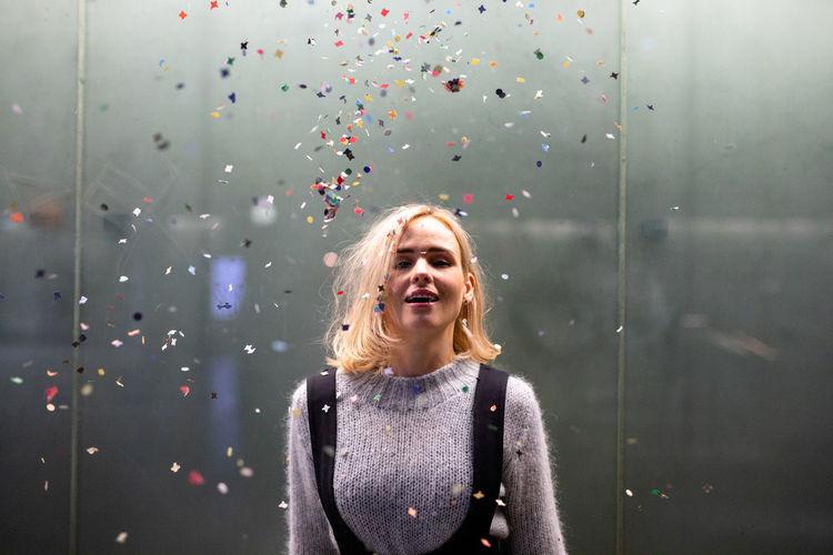 Portrait of beautiful woman behind glass window